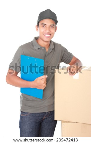 portrait of happy man courier in grey uniform delivering packages isolated on white background - stock photo