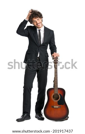 Portrait Of Happy Man Standing With Guitar Isolated On  White Background - stock photo