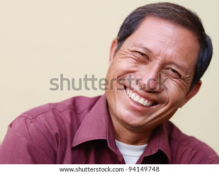 Portrait of happy mature Asian man smiling and looking at camera. Copy space - stock photo