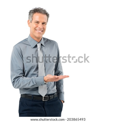 Portrait Of Happy Mature Businessman Presenting Isolated On White Background - stock photo