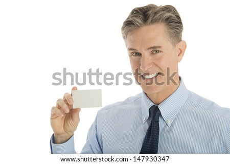 Portrait of happy mature businessman showing blank card against white background - stock photo