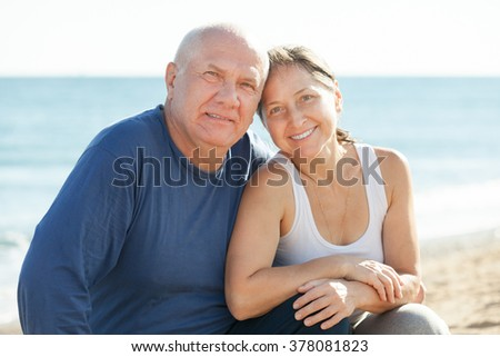 Portrait of happy mature couple at sea vacation - stock photo