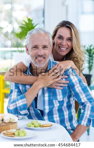 Portrait of happy mature couple in restaurant - stock photo