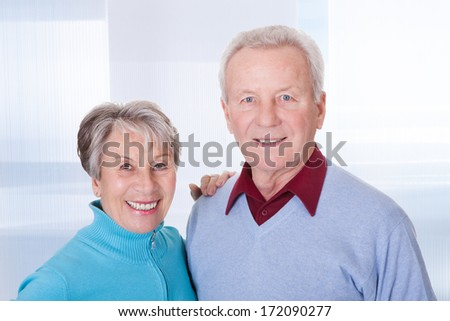 Portrait Of Happy Mature Couple Smiling At Home - stock photo