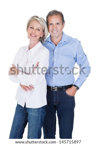 Portrait Of Happy Mature Lovely Couple Isolated Over White Background - stock photo
