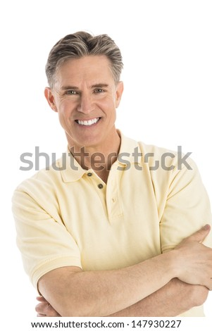 Portrait of happy mature man standing arms crossed over white background - stock photo