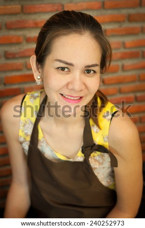 Portrait of happy mid adult waitress - stock photo