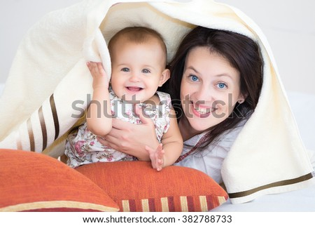 Portrait of happy mother and baby - stock photo
