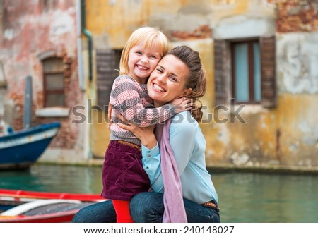 Portrait of happy mother and baby girl hugging while in venice, italy - stock photo