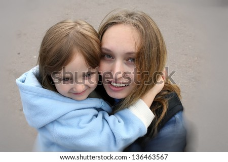 Portrait of happy mother and daughter - stock photo