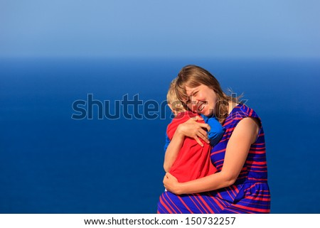 Portrait of happy mother and son on sea vacation - stock photo