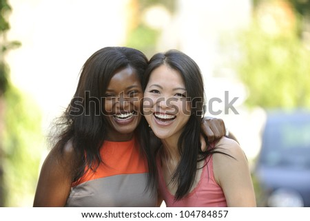 portrait of happy multiethnic friends - stock photo
