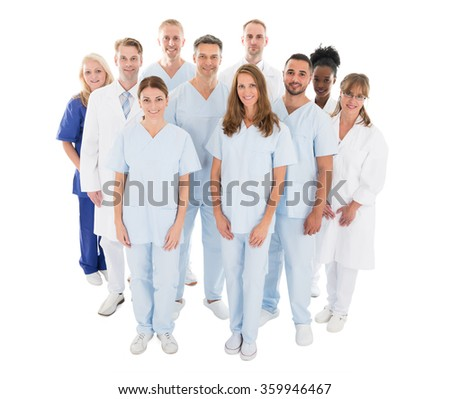 Portrait of happy multiethnic medical team standing against white background - stock photo