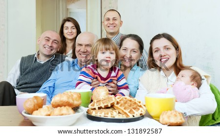 Portrait of happy multigeneration family or group of friends - stock photo