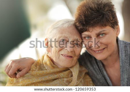 Portrait of happy old grandmother with daughter, closeup. - stock photo