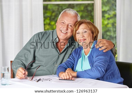 Portrait of happy old senior couple in a retirement home - stock photo