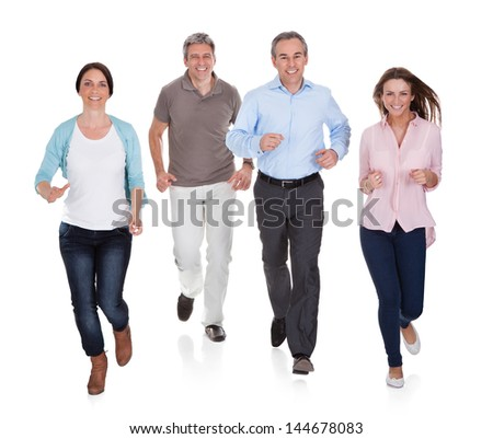 Portrait Of Happy People Running On White Background - stock photo