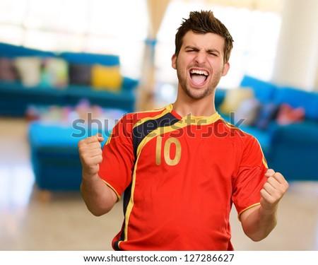 Portrait Of Happy Player, indoors - stock photo