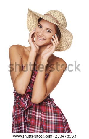 Portrait of happy playful woman in country style isolated on white  backgorund.  Smiling woman wearing chequered summer dress and broad-brim straw hat - stock photo