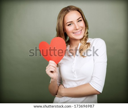 Portrait of happy romantic girl with red paper heart-shaped postcard, romantic wishes, Valentine day celebration, love concept - stock photo
