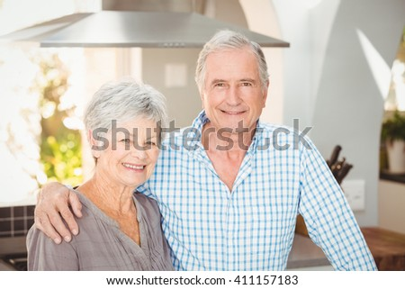 Portrait of happy senior couple at home - stock photo