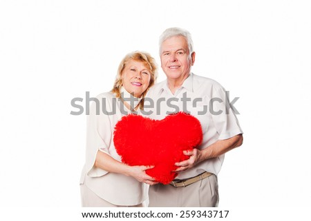 Portrait of happy senior couple in love. Isolated on white background. - stock photo