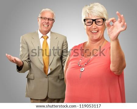 Portrait Of Happy Senior Couple On Gray Background - stock photo