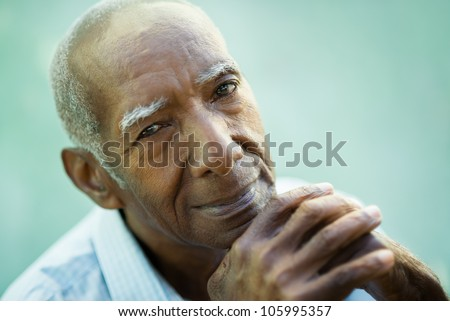 Portrait of happy senior hispanic man looking at camera and smiling. Close-up of face, copy space - stock photo