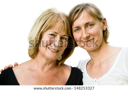 Portrait of happy senior mother with her adult daughter - isolated on white - stock photo