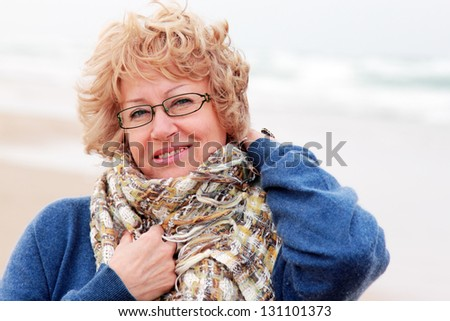 Portrait of happy senior woman at sea - stock photo