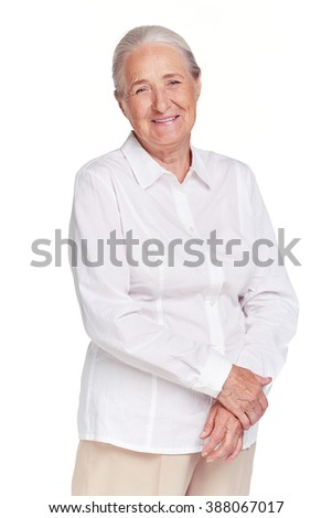 Portrait of happy senior woman isolated on white - stock photo