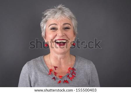 Portrait of happy senior woman smiling - stock photo