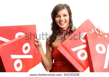Portrait of happy shopper with red paper bags looking at camera and smiling - stock photo
