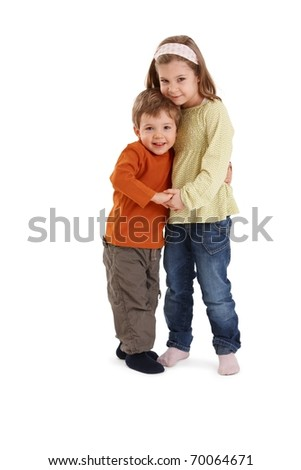 Portrait of happy siblings hugging each other, smiling at camera.? - stock photo