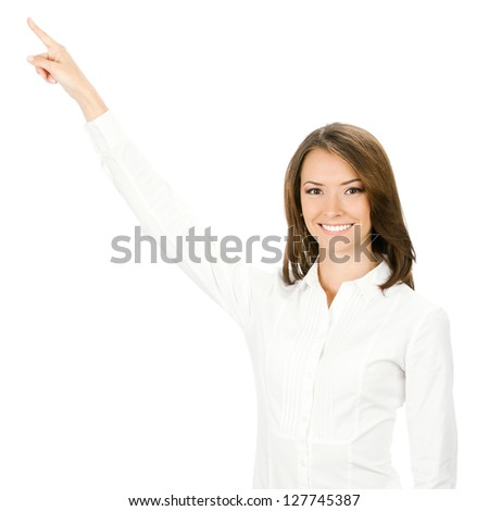 Portrait of happy smiling beautiful young cheerful business woman showing something, isolated over white background - stock photo