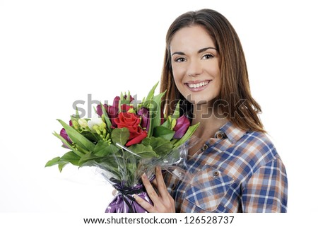 Portrait of happy smiling beautiful young woman with bouquet - stock photo