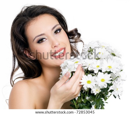 Portrait of happy smiling beautiful young woman with bouquet  flowers - isolated on white - stock photo
