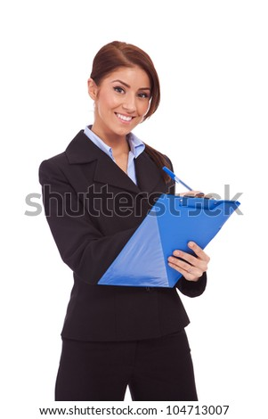 Portrait of happy smiling business woman with blue clipboard, writing, isolated on white background - stock photo