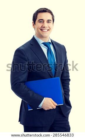 Portrait of happy smiling businessman with blue folder - stock photo