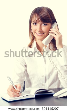 Portrait of happy smiling businesswoman calling by phone - stock photo