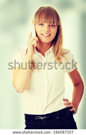 Portrait of happy smiling businesswoman on phone at office   - stock photo