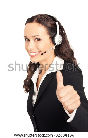 Portrait of happy smiling cheerful customer support phone operator in headset showing thumbs up gesture, isolated on white background - stock photo