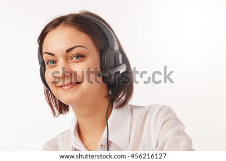 Portrait of happy smiling cheerful support phone operator in headset - stock photo