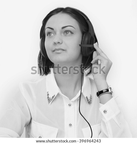 Portrait of happy smiling cheerful support phone operator in headset on white background - stock photo