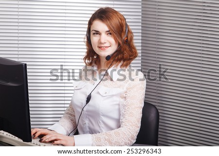 Portrait of happy smiling cheerful young support phone operator in headset - stock photo