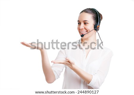 Portrait of happy smiling cheerful young support phone operator in headset showing copyspace area or something, isolated on white background - stock photo