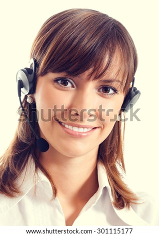 Portrait of happy smiling female support phone operator or call center worker in headset - stock photo