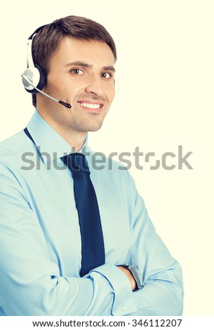 Portrait of happy smiling male customer support phone operator in headset - stock photo