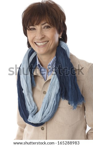 Portrait of happy smiling mature woman in scarf, looking at camera. - stock photo
