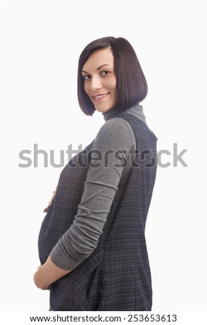 Portrait of Happy Smiling Pregnant Caucasian Woman Against White Background. Vertical Image Composition - stock photo